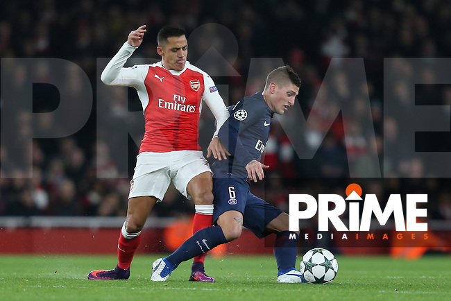 Alexis Sanchez of Arsenal and Marco Verratti of Paris Saint-Germain battle for the ball during the UEFA Champions League match between Arsenal and Paris Saint Germain at the Emirates Stadium, London, England on 23 November 2016. Photo by David Horn.