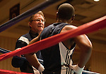February 3, 2012:   Nevada coach Michael Martino talks with his boxer Cordarius Taylor after his match at the Eldorado Convention Center on Friday night in Reno, Nevada.