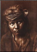 BNPS.co.uk (01202 558833)<br /> Pic: Bloomsbury/BNPS<br /> <br /> A Son Of The Desert from the Navaho tribe in 1904.<br /> <br /> Lost souls - Poignant archive reveals the lost tribes of North America in beautiful photographs from just over a century ago.<br /> <br /> A remarkable collection of photographs which give an unprecedented insight into the lives of Native Americans at a time when their land was being taken from them have emerged at auction.<br /> <br /> Between 1907 and 1930, US photographer Edward Curtis spent time with more than 80 native tribes across Native America, taking thousands of photographs as part of his groundbreaking The North American Indian project.<br /> <br /> A collection of more than 500 rare Curtis photographs are being auctioned off later this month and are expected to fetch over &pound;300,000.