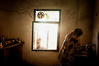 A woman uses one of the shared kitchens at the Cyber City Refugee Camp. This former electronics factory has been turned into a refugee camp for displaced Syrians, mostly of Palestinian origin. The six floor building is home to about 500 refugees.