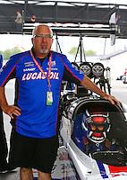 Apr 24, 2015; Baytown, TX, USA; PR rep Rob Geiger with NHRA  top fuel driver Richie Crampton during qualifying for the Spring Nationals at Royal Purple Raceway. Mandatory Credit: Mark J. Rebilas-