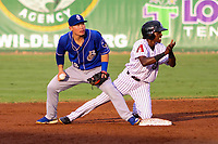 Biloxi Shuckers second baseman Keston Hiura (18) and Jackson Generals shortstop Jose Vinicio (20) react to an umpire's call during a Southern League game on July 26, 2018 at The Ballpark at Jackson in Jackson, Tennessee. Jackson defeated Biloxi 9-5. (Brad Krause/Four Seam Images)
