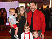 NWA Democrat-Gazette/CARIN SCHOPPMEYER Chrissy and Jason Fitzgerald, with their sons Jack (from left), Maddox, Open Your Heart ambassador, and Krew help support the American Heart Association at the Heart Gala on March 13 at the John Q. Hammons Center in Rogers.