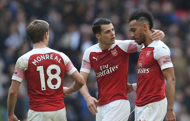 Arsenal's Pierre-Emerick Aubameyang is consoled by GranitXhaka after missing a late penalty<br /> <br /> Photographer Rob Newell/CameraSport<br /> <br /> The Premier League - Tottenham Hotspur v Arsenal - Saturday 2nd March 2019 - Wembley Stadium - London<br /> <br /> World Copyright © 2019 CameraSport. All rights reserved. 43 Linden Ave. Countesthorpe. Leicester. England. LE8 5PG - Tel: +44 (0) 116 277 4147 - admin@camerasport.com - www.camerasport.com