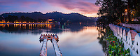 Panorama photo of Kandy Lake and the Temple of the Sacred Tooth Relic (Temple of the Tooth, Sri Dalada Maligawa) at sunrise, Kandy, Central Province, Sri Lanka, Asia. This is a panorama photo of Kandy Lake and the Temple of the Sacred Tooth Relic (Temple of the Tooth, Sri Dalada Maligawa) in Kandy at sunrise, Central Province of Sri Lanka, Asia. Kandy is the second largest city in Sri Lanka, and is home to beautiful Kandy Lake, a great place to visit for a walk at sunrise. The Sacred City of Kandy is one of eight UNESCO World Heritage Sites in Sri Lanka and is a popular tourist destination thanks to the Temple of the Sacred Tooth Relic (Temple of the Tooth, Sri Dalada Maligawa).