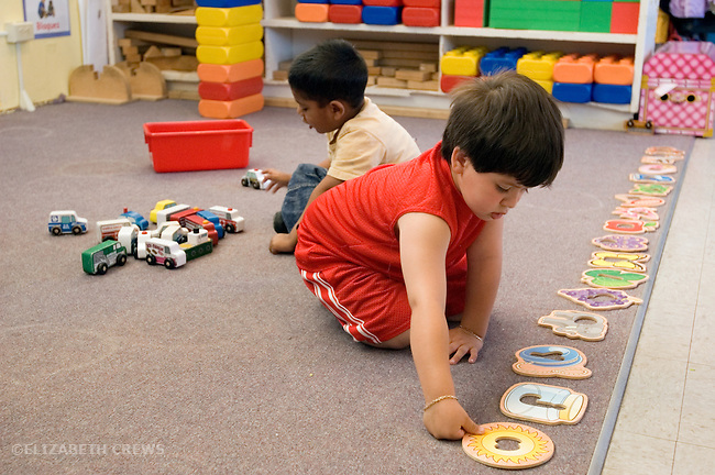 Berkeley CA Four-year-olds in solitary play at bilingual Spanish-English preschool
