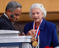 PHILADELPHIA - JULY 4: Philadelphia Mayor John F.Street (L) places the 2003 Liberty Medal around the neck of Supreme Court Justice Sandra Day O'Connor at the National Constitution Center on Independence Day July 4, 2003 in Philadelphia, Pennsylvania. The Liberty Medal was established in 1988 to honor individuals or organizations whose actions represent the founding principles of the United States. (Photo by William Thomas Cain/Getty Images)