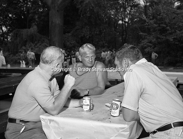 Bethel Park PA:  View of head fooball coach Rudy Andabaker talking with Jim Hannigan and Big Jim Westhoff during the annual Bethel Park Athletic Association picnic at Lyons Park.  <br /> The picnic gave the Bethel Park boosters a chance to meet the football team and coaches - 1973
