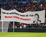 Nederland, Eindhoven, 29 maart 2014<br /> Eredivisie<br /> Seizoen 2013-2014 <br /> PSV-FC Groningen <br /> Supporters van PSV tonen een spandoek met de tekst: 'Van de Herdgang naar de top, Wilfred Bouma bedankt!'.