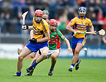 Paidi Fitzpatrick of Sixmilebridge in action against Michael Corry of Clooney-Quin during their senior county final replay at Cusack park. Photograph by John Kelly.
