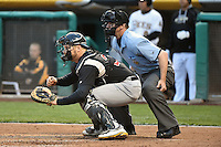 Stephen Vogt (26) of the Sacramento River Cats and home plate umpire Scott Mahoney during the game against the Salt Lake Bees at Smith's Ballpark on April 3, 2014 in Salt Lake City, Utah.  (Stephen Smith/Four Seam Images)