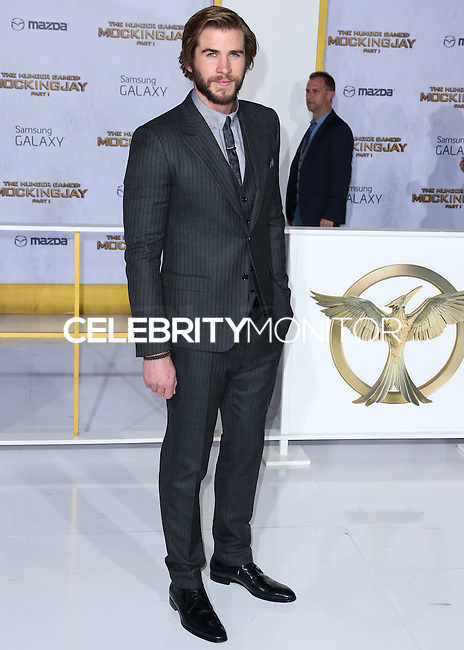 LOS ANGELES, CA, USA - NOVEMBER 17: Liam Hemsworth arrives at the Los Angeles Premiere Of Lionsgate's 'The Hunger Games: Mockingjay, Part 1' held at Nokia Theatre L.A. Live on November 17, 2014 in Los Angeles, California, United States. (Photo by Xavier Collin/Celebrity Monitor)