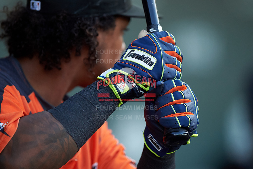 AZL Giants Orange Andrew Caraballo (1) warms up in the dugout during an Arizona League game against the AZL Cubs 1 on July 10, 2019 at Sloan Park in Mesa, Arizona. The AZL Giants Orange defeated the AZL Cubs 1 13-8. (Zachary Lucy/Four Seam Images)