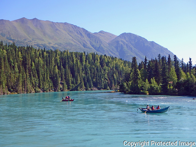 fishing and floating along the blue waters of the Kenai River, Alaska