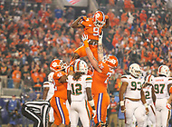 Charlotte, NC - December 2, 2017: Clemson Tigers running back Travis Etienne (9) celebrates after scoring a touchdown during the ACC championship game between Miami and Clemson at Bank of America Stadium in Charlotte, NC. Clemson defeated Miami 38-3 for their third consecutive championship title. (Photo by Elliott Brown/Media Images International)
