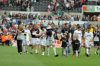 Pictured: Swansea City players and staff thanking their supporters after the end of their 4-0 win. Saturday 07 May 2011<br /> Re: Swansea City FC v Sheffield United, npower Championship at the Liberty Stadium, Swansea, south Wales.
