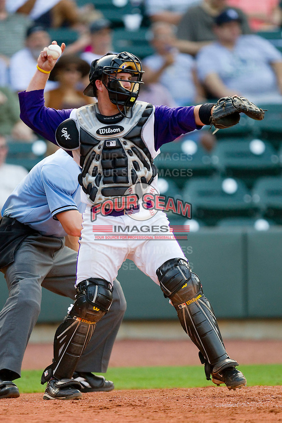 Catcher Logan Johnson #32 of the Winston-Salem Dash throws the ball back to his pitcher during a Carolina League game against the Salem Red Sox at  BB&T Ballpark June 27, 2010, in Winston-Salem, North Carolina.  Photo by Brian Westerholt / Four Seam Images