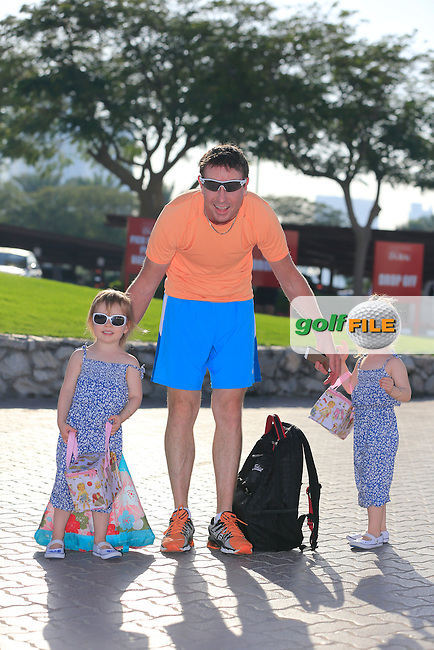 Brett Rumford (AUS) with twins Lulu and Violet at the end of Wednesday's Pro-Am of the Omega Dubai Desert Classic 2014 held at the Emirates Golf Club, Dubai. 28th January 2014.<br /> Picture: Eoin Clarke www.golffile.ie