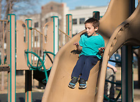 NWA Democrat-Gazette/BEN GOFF @NWABENGOFF<br /> Branden Bibrowicz, 5, of Springdale plays Thursday, Dec. 21, 2017, at Dave Peel Park in downtown Bentonville. Funding from a Walton Family Foundation Design Excellence Program grant is slated to be used for a redesign of the popular park near the downtown square.