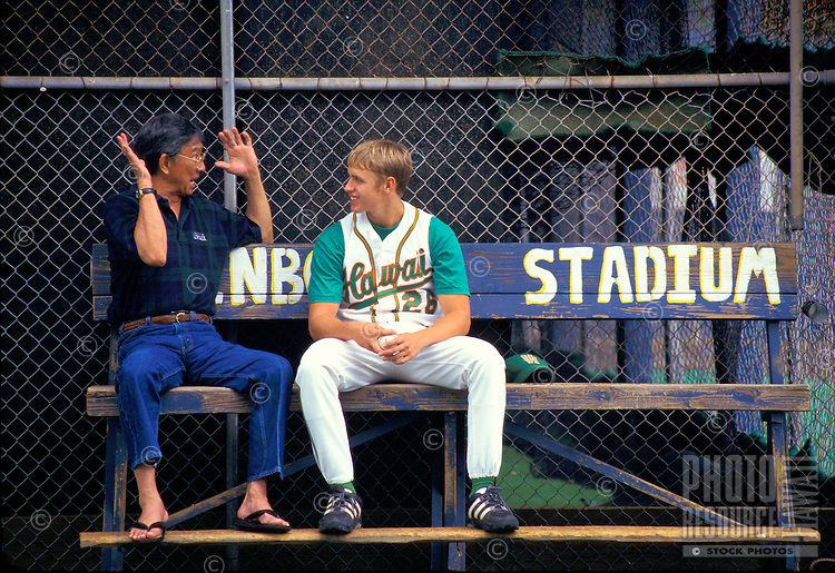 University of Hawaii baseball players sits at the stadium with an advisor