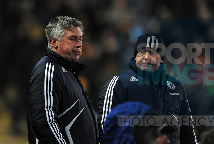 Dejection for Carlo Ancelotti manager of Chelsea and assistant Ray Wilkins