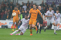 Jean-Louis Akpa Akpro of Barnet passes under pressure from Darren Jones of Newport County during the Sky Bet League 2 match between Newport County and Barnet at Rodney Parade, Newport, Wales on 3 September 2016. Photo by Mark  Hawkins / PRiME Media Images.