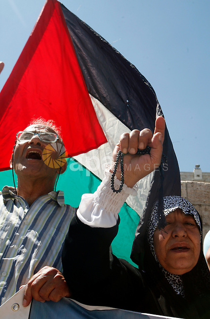 Palestinians hold national flag and shout slogans during a protest against continuing of 'Judaization of Jerusalem' by Jewish settlers and confiscating Palestinian lands at Damascus gate after Friday prayer in east jerusalem, on June 8, 2012. Photo by Mahfouz Abu Turk