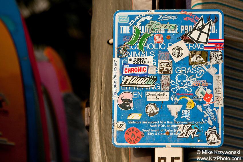 Sign covered w/ surfing decals in Waikiki, Honolulu, Oahu, Hawaii
