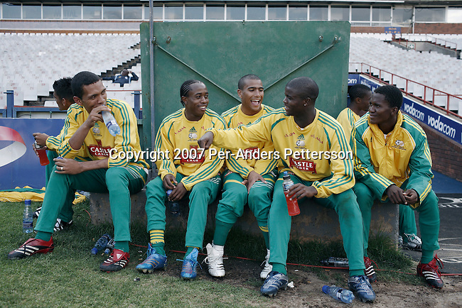 PRETORIA, SOUTH AFRICA - SEPTEMBER 28: Members of the South African national soccer team relaxes after a practice, a day before a game against Botswana on September 28, 2007 in Pretoria, South Africa. The team, ranked 77 in the world, has had a history of bad performances and more than ten coaches since 1996. Carlos Alberto Parreira, the legendary Brazilian coach, now coaches them and he has the tough task of building up the team until 2010. Soccer is the most popular sport in South Africa, and because of the upcoming World Cup 2010 in South Africa the interest is increasing. For the first time the World Cup will be held on the African continent. .(Photo by Per-Anders Pettersson)....