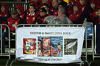 Fans watch from behind a tour banner during the 2017 DHL Lions Series rugby union match between the NZ Maori and British & Irish Lions at Rotorua International Stadium in Rotorua, New Zealand on Saturday, 17 June 2017. Photo: Dave Lintott / lintottphoto.co.nz