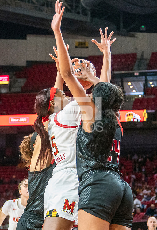 COLLEGE PARK, MD - FEBRUARY 9: Kaila Charles #5 of Maryland shoots over Arella Guirantes #24 of Rutgers during a game between Rutgers and Maryland at Xfinity Center on February 9, 2020 in College Park, Maryland.