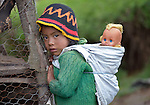 Three-year old Nely Roxana Miranda carries her blond doll on her back in Buena Vista Bacchuc, a small Mam-speaking Maya village in Comitancillo, Guatemala.