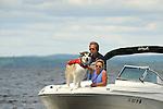 Alaskan Malamute on deck of boat.