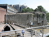 London, England, GBR - August 11, 2003 -- This is one of the most impressive surviving sections of London's former city wall.  The lower part, with its characteristic tile bonding courses, was built by the Romans around 200 AD.  Its purpose may have been as much to control the passage of goods and people as for the defense.  Against its inner face, on this side, the wall was reinforced by a substantial earth rampart.  Outside was a wide ditch.  In the far right hand corner, evidence of an internal turret was found in excavation.  This probably contained a staircase giving access to the sentry walk.  Complete with its battlements, the Roman wall would have been about 6.4 metres high.  During the medieval period, the wall was repaired and heightened.  From the 17th century it fell into disuse and parts were demolished.  Several sections, including this one, were preserved by being incorporated into later buildings..Credit: Ron Sachs / CNP