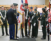 The color guard gets ready. - The Northeastern University Huskies defeated the Harvard University Crimson 4-0 in their Beanpot opener on Monday, February 7, 2011, at TD Garden in Boston, Massachusetts.