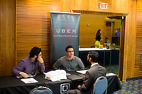 Ali Malik, an Army veteran from Queens, New York, speaks with Uber representatives who asked not to be named at the Recovering Warrior Employment Conference at the Back Bay Event Center in Boston, Massachusetts, USA. The employment conference was organized by Hiring Our Heroes and Wounded Warrior Project. Hiring Our Heroes is an initiative of the US Chamber of Commerce Foundation. Approximately 40 veterans registered for the event, during which they had interviews with a number of different regional and national employers, including GE, Bank of America, Uber, and others.