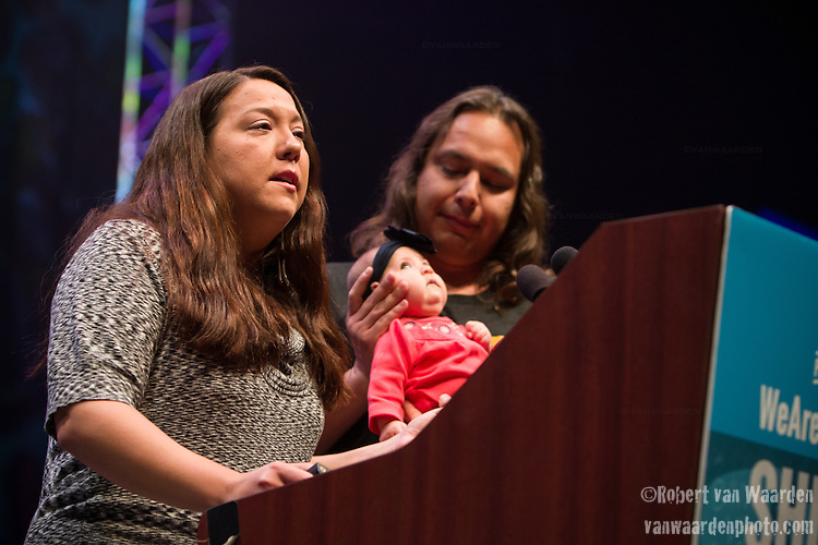 Kandi Mossett from the Indigenous Environment Network speaks at Powershift. To her left is Ayanna and her partner Loren. Over six thousand young people from all over the country are converging in Pittsburgh, PA for Power Shift 2013, a massive training dedicated to bringing about a safe planet and a just future for all people. (Photo by: Robert van Waarden)