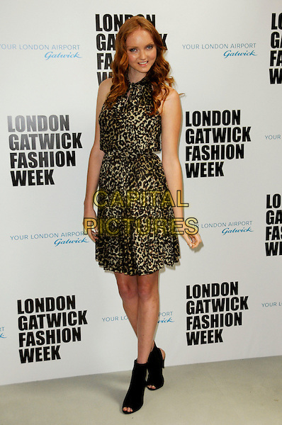 LILY COLE .Photocall to announce the winners of the Gatwick Runway Models competition at Gatwick Airport North Terminal, London, England..August 6th, 2010.full length brown black leopard print dress open toe ankle boots sleeveless .CAP/CAS.©Bob Cass/Capital Pictures.