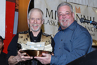 Jeff King (L) recieves the Millenium Hotel 1st musher to the Yukon award from Patrick Cashman at the finishers banquet in Nome on Sunday  March 22, 2015 during Iditarod 2015.  <br /> <br /> (C) Jeff Schultz/SchultzPhoto.com - ALL RIGHTS RESERVED<br />  DUPLICATION  PROHIBITED  WITHOUT  PERMISSION