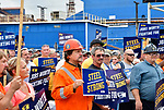 Steelworkers hold signs during a rally held outside the main entrance to Granite City Steel on Thursday August 30, 2018.  The Granite City plant is visible behind them. The local rally was part of a nationwide day of action by steelworkers as their collective bargaining contracts expire on September 1.  <br /> Photo by Tim Vizer