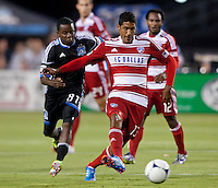 Santa Clara, California - Saturday July 18, 2012: FC Dallas' Hernan Pertuz dribbles the ball away from San Jose Earthquakes' Marvin Chavez at Buck Shaw Stadium, Stanford, Ca   San Jose Earthquakes defeated FC Dallas 2 - 1.