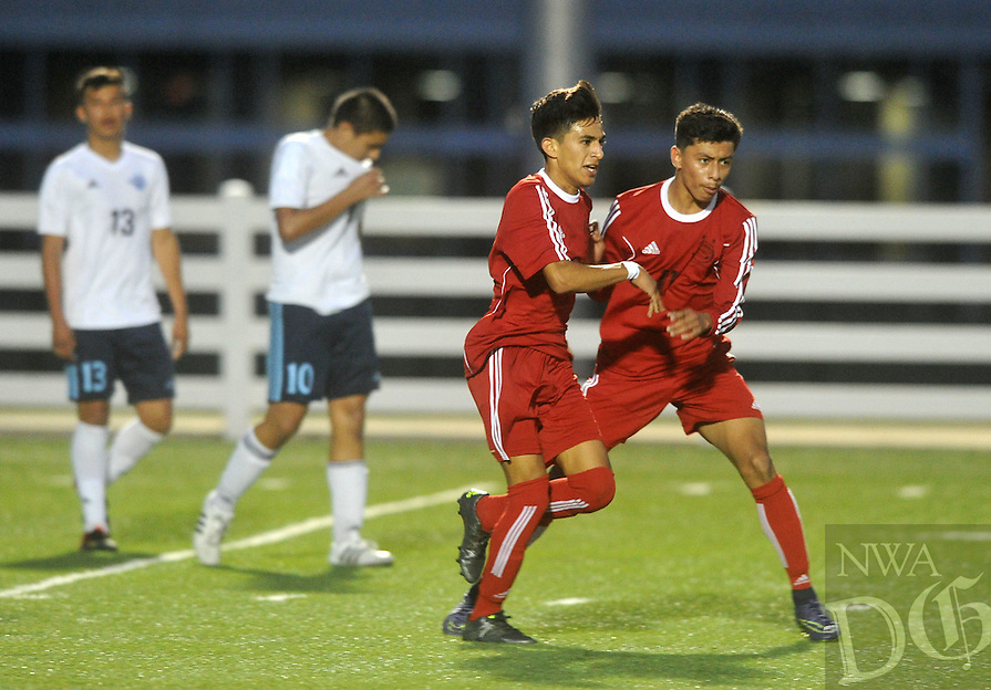NWA Democrat-Gazette/MICHAEL WOODS &bull; @NWAMICHAELW<br /> Springdale;s Leo Araujo (9) celebrates with teammate Salvador Gonzalez (11) after scoring a goal in the first half against Har-Ber Tuesday April 19, 2016at Har-Ber High.