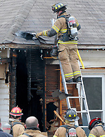 NWA Democrat-Gazette/DAVID GOTTSCHALK Members of the city of Rogers Fire Department continue to look for hot spots Monday, March 12, 2018, following a structure fire at 622 Electric Street. According to the Rogers Fire Department no injuries were reported and the cause of the fire is still under investigation.