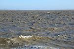 Choppy grey sea waves off the coast at Bawdsey, Suffolk, England, UK