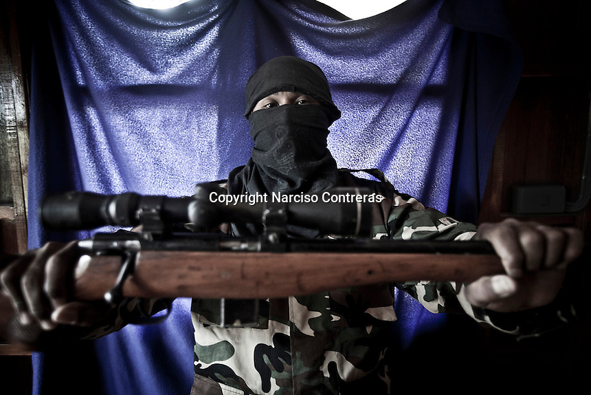 A KNLA militiaman and leader of the ethic civilian movement from Karen State at the bordertown of Mae Sot, Thailand.