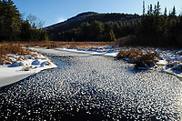 Mill Brook in winter with frost crystals on the ice in the Adirondack Mountains in New York State
