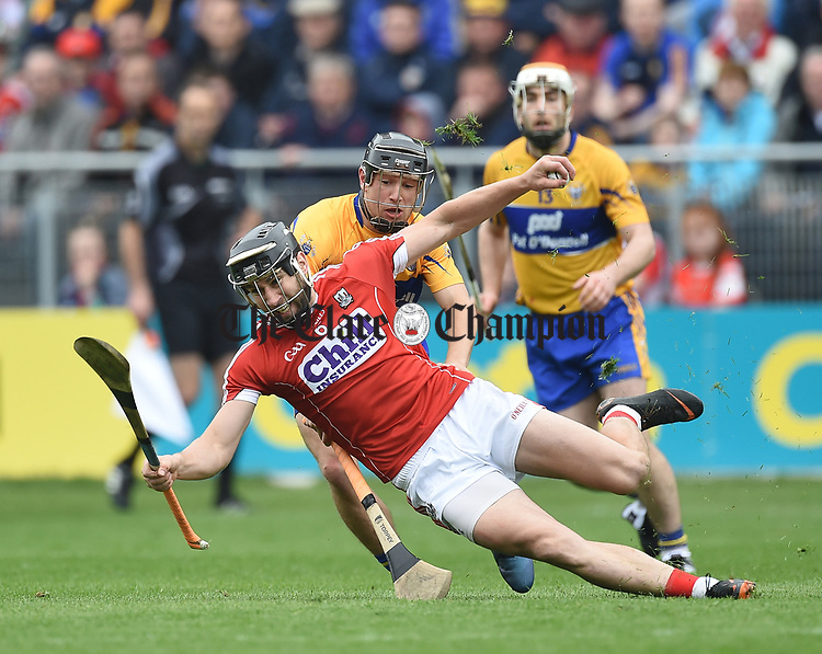 David Reidy of Clare in action against Mark Ellis of Cork during their Munster Senior game at Pairc Ui Chaoimh. Photograph by John Kelly.