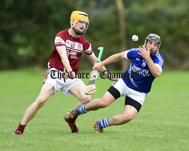 Barry Gleeson of Cratloe in action against Daragh O Sullivan of St Joseph's Doora Barefield during their round three senior championship game in Sixmilebridge. Photograph by John Kelly