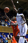 08 January 2015: Syracuse's Alexis Peterson (left) has a shot blocked by Duke's Elizabeth Williams (right). The Duke University Blue Devils hosted the Syracuse University Orange at Cameron Indoor Stadium in Durham, North Carolina in a 2014-15 NCAA Division I Women's Basketball game. Duke won the game 74-72.