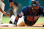 5 September 2009: Minnesota Twins' left fielder Denard Span dives safely back to first base in a pick-off attempt by the Cleveland Indians at Progressive Field in Cleveland, Ohio. The Twins defeated the Indians 4-1 in the second game of their three-game weekend series. Mandatory Credit: Ed Wolfstein Photo